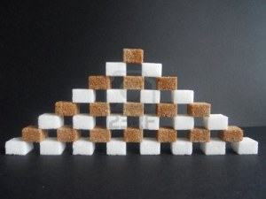 8879408-diabetes-white-and-brown-sugar-cubes-pyramid-on-black-backround